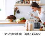 young woman standing by the... | Shutterstock . vector #306416300