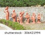 Series of Buddhist novice holding alms bowl clay dolls, Phuket, Thailand - stock photo