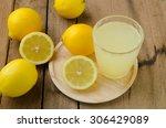 freshly lemon juice in glass on ... | Shutterstock . vector #306429089