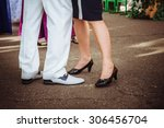 man's and woman's legs during a ... | Shutterstock . vector #306456704