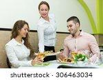 positive waitress serving meal... | Shutterstock . vector #306463034