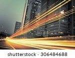 the light trails on the modern... | Shutterstock . vector #306484688