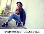 fashion model with long curly... | Shutterstock . vector #306512468