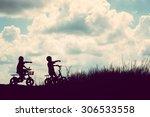 Two Little Boys Bike Silhouette