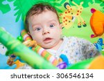 3 months old baby boy playing... | Shutterstock . vector #306546134