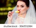 beautiful bride eating yellow... | Shutterstock . vector #306551084