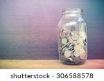 money in the glass with filter... | Shutterstock . vector #306588578