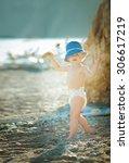 little boy in a diaper outdoors   Shutterstock . vector #306617219