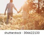 Lovers Walking In A Field At...
