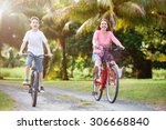 family of mother and son biking ... | Shutterstock . vector #306668840