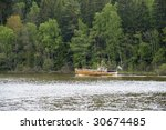 Boat on a lake - stock photo