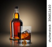 bottle and glass of whiskey | Shutterstock . vector #306811610