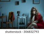 nervous girl sitting on the bed ... | Shutterstock . vector #306832793