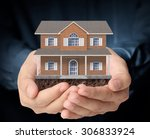 holding house representing home ... | Shutterstock . vector #306833924