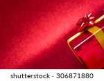 red gift box with red background | Shutterstock . vector #306871880