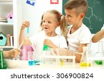 cute pupils doing biochemistry... | Shutterstock . vector #306900824