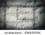 rivets on a metal plate | Shutterstock . vector #306935504