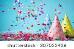 Stock photo colored confetti and party hat on blue background 307022426
