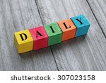 word daily on colorful wooden... | Shutterstock . vector #307023158