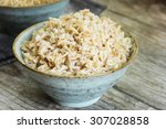 cooked brown basmati rice in a... | Shutterstock . vector #307028858