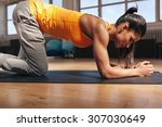 young woman exercising on... | Shutterstock . vector #307030649