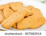 Gingerbread - Gingerbread man Plain gingerbread man on a white plate. - stock photo