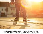 child with skateboard on the... | Shutterstock . vector #307099478
