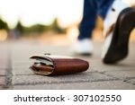 Stock photo girl had lost leather wallet with money on the street close up of wallet lying on the sidewalk and 307102550