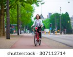 Young Happy Woman On Bike In...