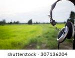 one earphone at green field in... | Shutterstock . vector #307136204