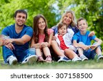 happy parents posing with three ... | Shutterstock . vector #307158500