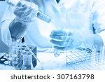 conical flask in scientist hand ... | Shutterstock . vector #307163798
