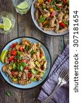whole wheat pasta  with chicken ... | Shutterstock . vector #307181654
