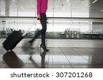 woman walking in airport ...   Shutterstock . vector #307201268