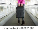 woman holding suitcase in... | Shutterstock . vector #307201280
