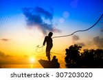 Silhouettes Fisherman Throwing...