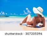 fit woman in sun hat and bikini ... | Shutterstock . vector #307205396