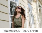 girl in sunglasses  smiling  | Shutterstock . vector #307247198