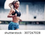 fitness woman on stadium | Shutterstock . vector #307267028