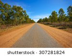 A Long  Narrow Paved Road In...