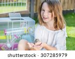 happy little girl sitting in... | Shutterstock . vector #307285979