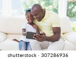 happy smiling father using... | Shutterstock . vector #307286936