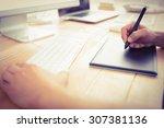 graphic designer working with... | Shutterstock . vector #307381136