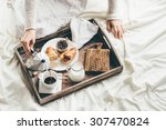 woman having breakfast in bed.... | Shutterstock . vector #307470824