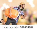 tourist running fast on... | Shutterstock . vector #307483904