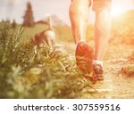 Stock photo man legs on the mountain footpath close up image 307559516