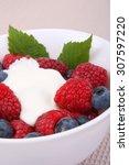fresh raspberries and berry... | Shutterstock . vector #307597220