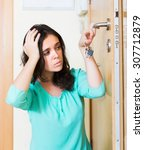 upset young housewife trying to ... | Shutterstock . vector #307712879