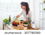 woman preparing dinner in a... | Shutterstock . vector #307780580