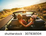 happy young couple driving... | Shutterstock . vector #307838504